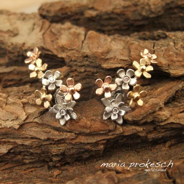 Blomster øresmykke i tre farver guld